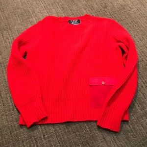 Red crewneck sweater with pocket